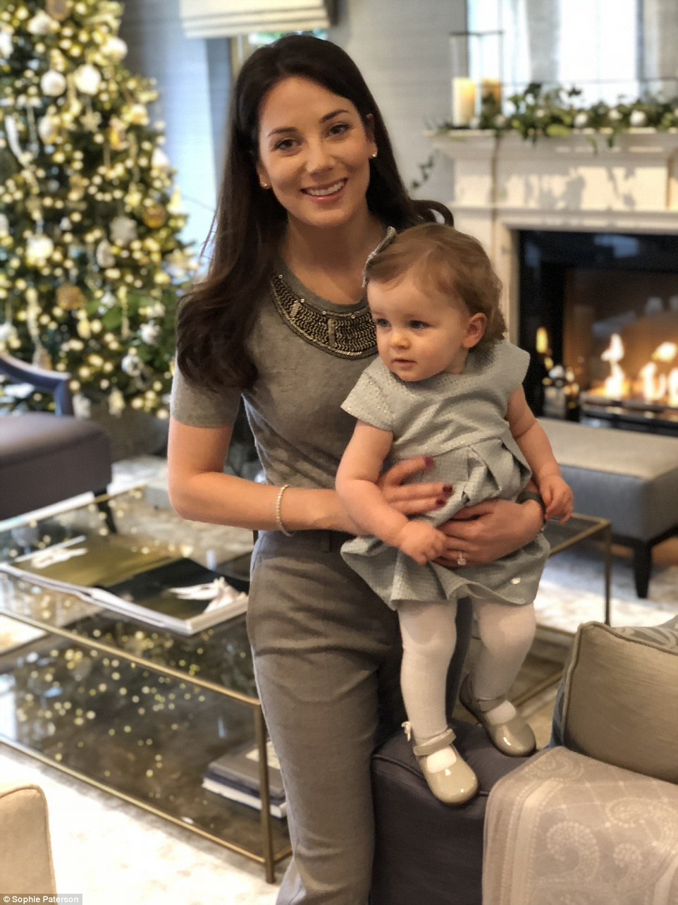 Sophie Paterson, 33, from Surrey, pictured with baby Ava, has opened the doors to her mansion for FEMAIL and revealed how she makes her plush home look so chic at Christmas. Sophie has four trees in her house and says she likes to match the decorations and general theme to the interiors of the room (something she is very well-versed in thanks to her job)